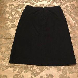 Simple black skirt.